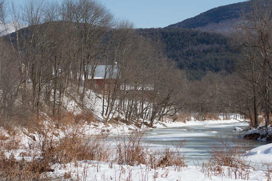 Barn on the River viewed through the trees. Looks like a painting waiting to happen to me!